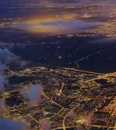 Aerial view of city landscape at night