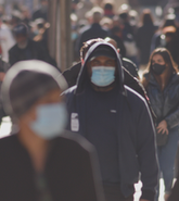 Pedestrians wearing masks